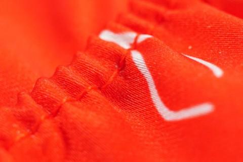 Custom mini football kit stitching detail
