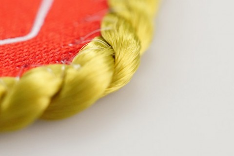 Custom pennant cord border design detail